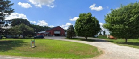 Photo of our Location beside some of our Contact info.